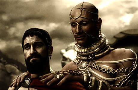 Screenshot from the film 300 of the androgynous Persian God-king, Xerxes, giving King Leonidas a massage. Ok, no. They were discussing the possibility of a Spartan surrender